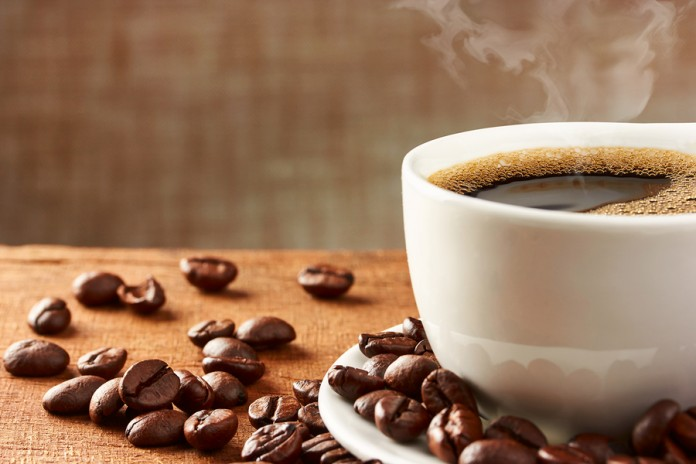 bigstock-Coffee-Cup-And-Coffee-Beans-84244856-696x464