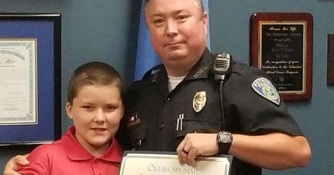 Image of Police Officer Adopts 8-Year-Old Boy He Saved From Severe Child Abuse