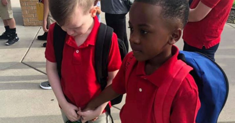 Image of Heartwarming moment as little boy comforts his crying autistic classmate