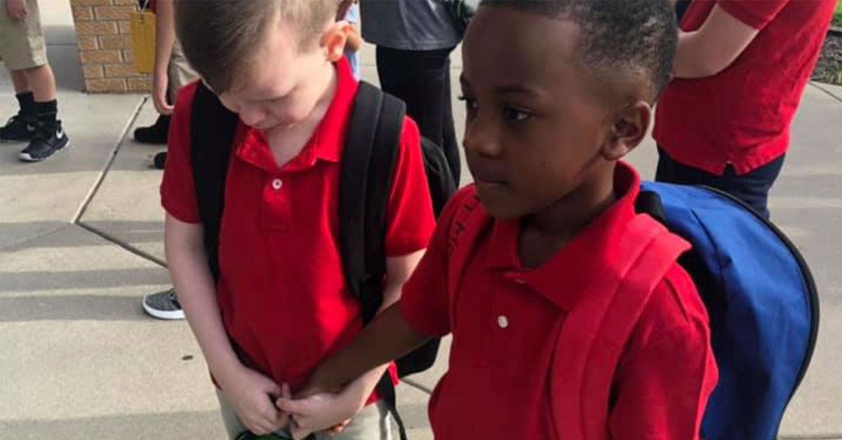 Heartwarming moment as little boy comforts his crying autistic classmate