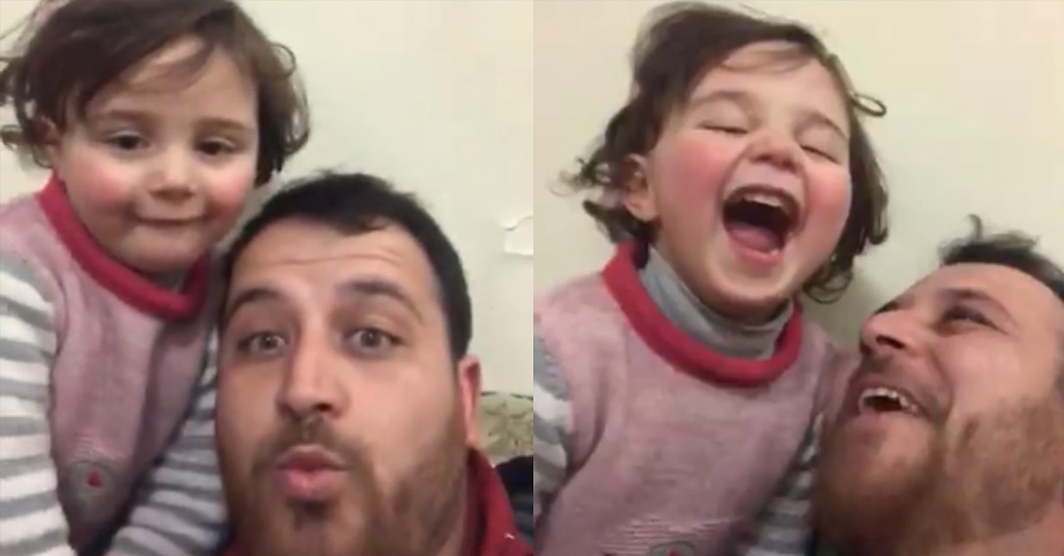 Heartbreaking Video Shows Syrian Father Teaching His 4-year-old Girl to Laugh at Bombs as a Coping Mechanism